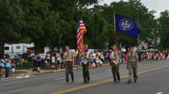 Boy Scouts march the US flag and Utah flag to start annual small town parade Stock Footage