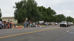 Time lapse-Small town summer celebration parade Stock Footage