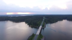 Aerial orbit around the Farrington road bridge at Jordan lake. Stock Footage