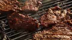 Closeup of meat on BBQ grill Stock Footage