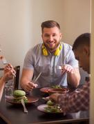 Happy friends in vegan restaurant Stock Photos