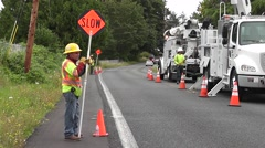 Workers Direct Traffic Around Utility Truck Arkistovideo