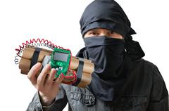 Terrorism concept. Terrorist holds dynamite bomb in hand. Isolated on white b Stock Photos