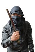 Terrorist holds bloody knife. Isolated on white. Terrorism concept. - stock photo