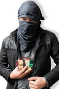 Terrorist puts dynamite bomb in jacket. Terrorism concept. Isolated on white. Stock Photos