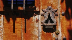 Door handle on an ancient door. In the town of Rupit, Spain Stock Footage