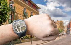 Hand with smart watch and GPS navigation system. Stock Photos