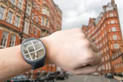 GPS navigation system on smart watch. Modern technology concept. Stock Photos