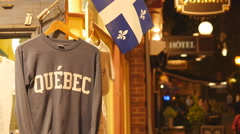 Quebec shirt and flag outside tourist shop. Quebec City, Canada. Stock Footage