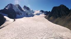 4K aerial view pan around mountain glacier lake bolivia pico austria Stock Footage