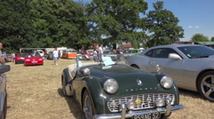Old Triumph TR3B (1959) in a vintage collector's car - zoom out Stock Footage