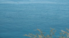Slow pan across the Greek blue summer sea at noon. - stock footage