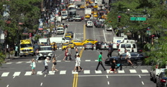 New York City manhattan busy street traffic and people walking crossing street Stock Footage