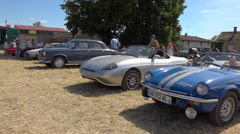 Vintage collector's car meeting in France -Triumph TR3B & Spitfire 1500 - pan Stock Footage