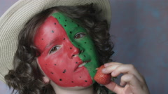 4k Shot of a Cute Child with Coloured Face Bitting strawberry Stock Footage