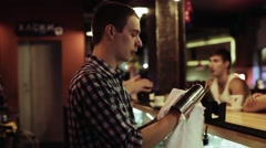 Young bartender working at the bar Stock Footage