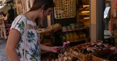 Young girl choosing a limoncello in store, Amalfi Coast, Italy Stock Footage