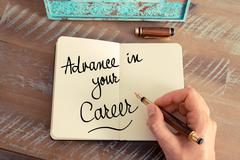 Handwritten text Advance In Your Career - stock photo