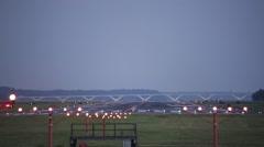 Plane landing at night in Washington DC Stock Footage