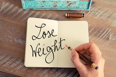 Handwritten text Lose Weight Stock Photos