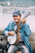 Street Busker performing jazz songs at the Charles Bridge in Prague Kuvituskuvat
