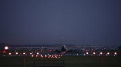 Airplane taking off then a plane landing at night, Washington DC Stock Footage