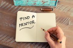 Handwritten text Find A Mentor Stock Photos