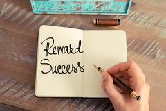 Handwritten text Reward Success - stock photo
