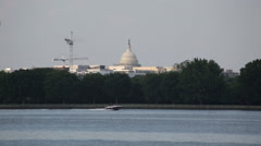 Boat passing in front of the Capitol Building in Washington DC Stock Footage