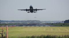 Plane taking off towards camera at Ronald Reagan Washington National Airport Stock Footage