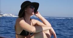 Attractive Woman enjoy a Boat Travel on Capri Island, Italy Stock Footage