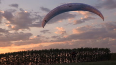 Paramotor Flying at Sunset and Beautiful Clouds Stock Footage