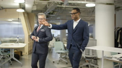 4K Smart executive business managers walking through modern office Stock Footage