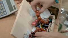 Bracelets made out of wooden beads fit for all Stock Footage
