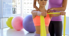 Fitness trainer advising her customer - stock footage
