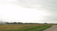 Aircraft plane is landing in an open grass field Stock Footage