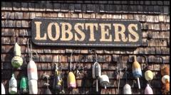 Lobster buoys on a New England house. Stock Footage