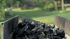 Hot smoking char coals in barbecue grill brazier - stock footage