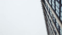 View of Camera Right at High-Rise Building. Grey Sky, Mainly Cloudy. Rapid Stock Footage