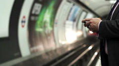 Business man texting messagge while waiting for the tube Stock Footage