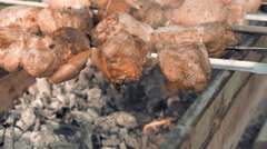 Barbecue skewers with meat cooking on the grill Stock Footage