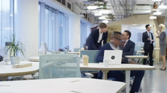 4K Time lapse of busy corporate business team working hard in modern office Stock Footage