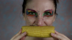 4k Shot of a Woman with Multicoloured Make-up Eating Corn Stock Footage