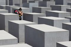 Traveler at Holocaust memorial / jewish memorial in Berlin Kuvituskuvat