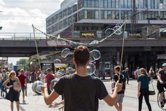 Soap bubble performer on Alexanderplatz in Berlin - stock photo