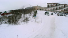 Car Driving out the Parking and Heading to Mountains Stock Footage