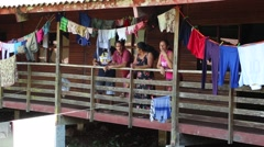 Cuban Family Resting on Veranda of Immigrant Facility Stock Footage