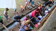 Women Washing Clothes in Line at Cuban Immigrant Facility Stock Footage