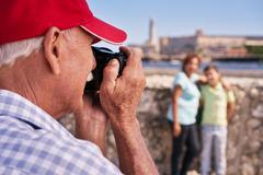Grandparents With Boy Family Holidays Grandpa Taking Photo Stock Photos