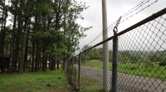 Isolated Shot of Chain Link Fence with Barbed Wire Stock Footage